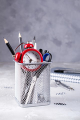 Minimalistic school or office workspace with gray stationery on concrete background. Education concept. Back to school.
