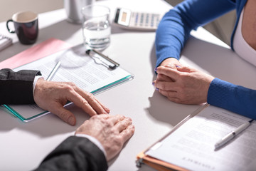 Business negotiation between businesswoman and businessman