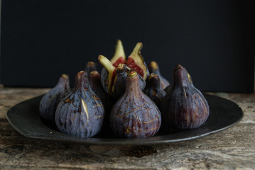 Close up of fresh figs on plate