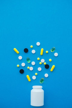 Medical Pills. Colored Pills And Capsule On Blue Background. Pharmacy Theme, Capsule Pills With Medicine Antibiotic in Packages