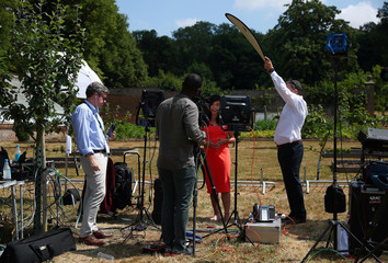 Members of the U.S. media film a news clip whilst the U.S. President has a working lunch at Chequers, the official residence of the British Prime Minister, near Aylesbury