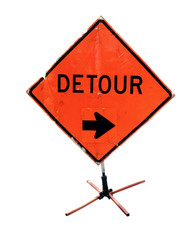 Battered DETOUR sign with arrow on construction tripod. Isolated.