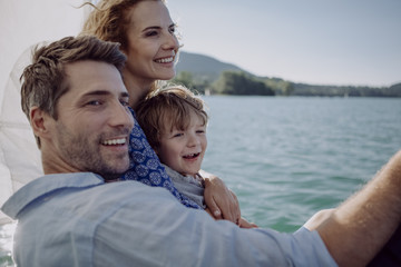Happy family on a sailing trip