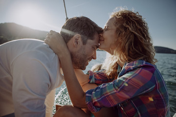 Affectionate couple with son on a sailing boat