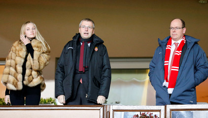 Prince Albert II of Monaco, Dmitri Rybolovlev of Russia, President of AS Monaco Football Club, and Anna Barsukova await the start of the French League Cup soccer semi-final soccer match between Monaco and Bastia in Monaco