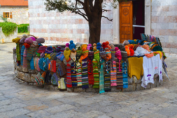 Colored knitted hats for sale in the old town of Budva.