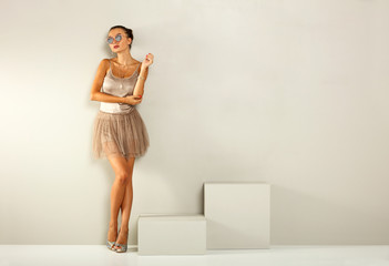 Slim young woman and free space for your decoration.