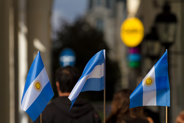 Three Argentine flags on a panel in a street stall selling souvenirs