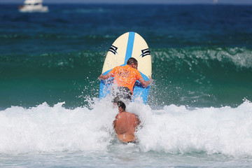 Surfers take part in the championship for physically challenged competitors off the coast of the port city of Ashdod in Israel