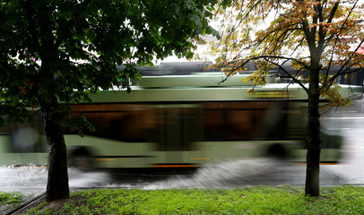 Trolley splashes water during heavy rain in central Minsk