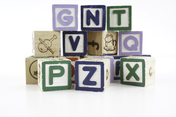 Colored wooden letter blocks on a white background with copy space