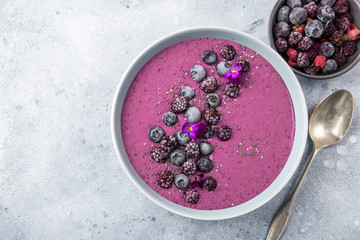 delicious blueberry smoothie bowl with frozen berries