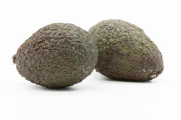 two avocados, isolated on white background