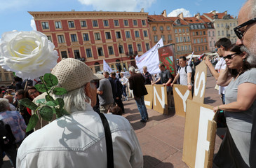 People participate in the protest during the special joint session of Polish parliament, held to mark the centennial of Polish independence and 550 years of parliamentary traditions at the Castle Square in Warsaw