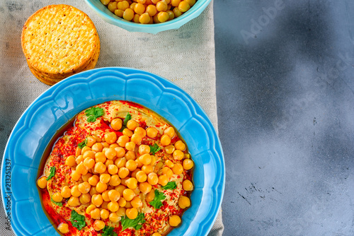 Hummus and tahini with olive oil, pepper, Chickpea, parsley