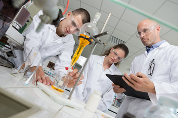two young researchers carrying out experiments in a lab