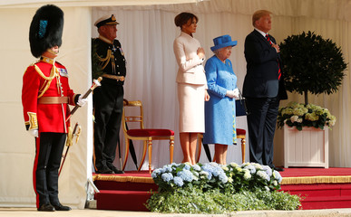U.S. President Donald Trump and the First Lady Melania Trump are met by Britain's Queen Elizabeth as they arrive for tea at Windsor Castle in Windsor