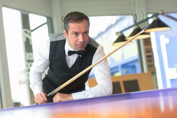 Snooker player contemplating next shot