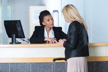 woman asking a receptionist