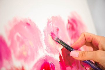 Artist close-up painting flowers.