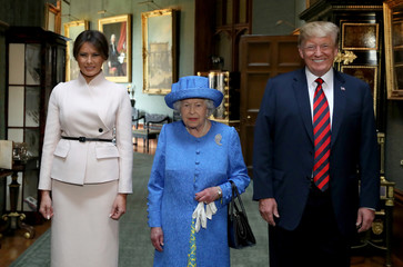 Britain's Queen Elizabeth stands with U.S. President Donald Trump and his wife, Melania in the Grand Corridor during their visit to Windsor Castle, Windsor