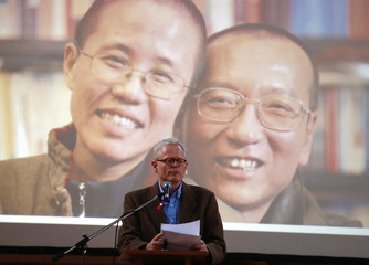 Journalist Ian Johnson speaks during a memorial event to mark the first anniversary of Chinese Nobel Peace Prize-winning political dissident Liu Xiaobo's death at Gethsemane church in Berlin