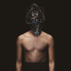 Portrait of shirtless man with mask
