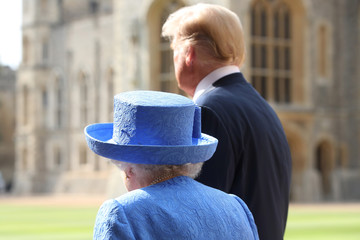 U.S. President Donald Trump and Britain's Queen Elizabeth walk from the Quadrangle after inspecting an honour guard a at Windsor Castle, Windsor
