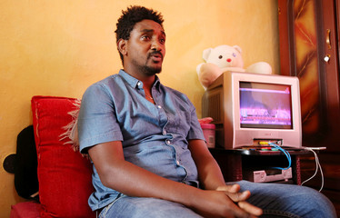 Daniel Dagnaw, a former Eritrean military officer and refugee talks during a Reuters interview in his apartment in Addis Ababa