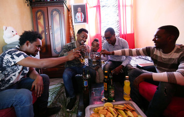 Eritrean refugees in Ethiopia share a toast on the news about Ethiopia and Eritrea peace deal in their apartment in Addis Ababa