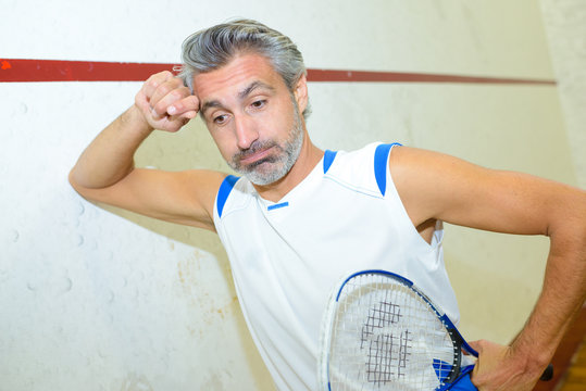 squash player looking exhausted