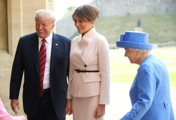 U.S. President Donald Trump, First Lady Melania Trump and Britain's Queen Elizabeth Queen walk from the Quadrangle after inspecting an honour guard, Windsor
