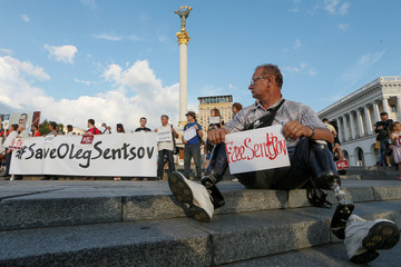 Participants attend a rally demanding the release of film director Oleg Sentsov and other Ukrainian political prisoners in Russia, at the Independence Square in Kiev