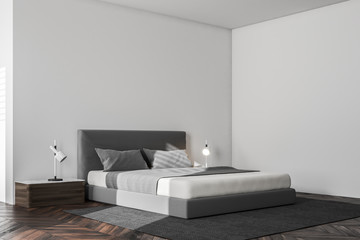 Minimalistic white bedroom corner
