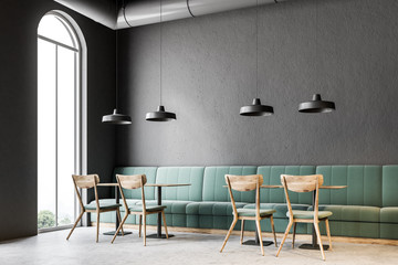 Dark gray wall bar corner, green sofas