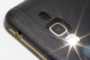 close up of a mobile phone camera with lightflash
