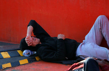 A migrant rests on a rescue boat after arriving at the port of Algeciras