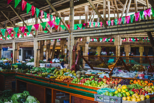 Colorful food market with red and green bunting in Cali, Colombia