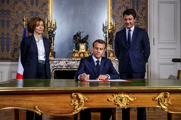 French President Emmanuel Macron signs the annual armed forces budget in Paris