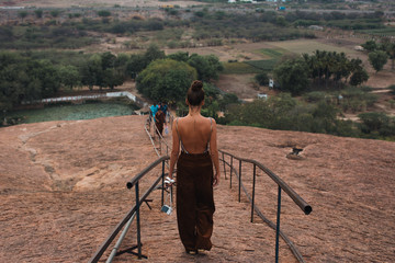 Woman walking down pathway