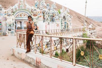 Woman holding camera at Meenakshi Temple