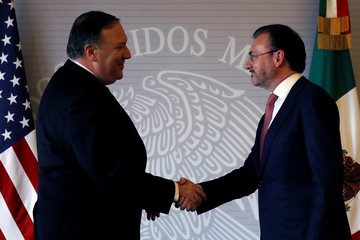 U.S. Secretary of State Mike Pompeo and Mexico's Foreign Minister Luis Videgaray shake hands after delivering a joint statement in Mexico City