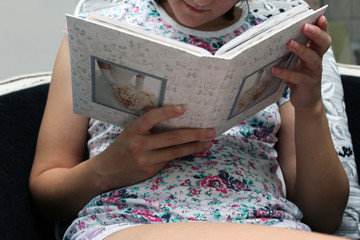 girl holding a photo album