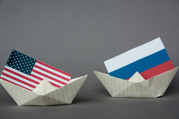 paper ship with Flags of USA and Russia. conflict  concept shipment or free trade agreement and membership. grunge image