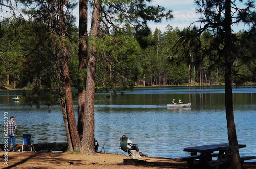 People fishing on the banks and in boats at South Twin Lake