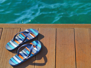slippers on the seaside pier