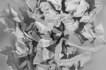 Black and white crumbled pieces of paper textured background