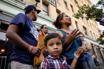 Rosayra Pablo-Cruz, a Guatemalan mother who had been separated from her two sons, speaks to the press as she exits the Cayuga Center after being reunited with them in New York