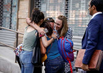 Rosayra Pablo-Cruz, a Guatemalan mother who had been separated from her two sons,  is greeted as she exits the Cayuga Center after being reunited with them in New York