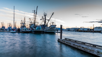 Amazing sunset over boats. Port of Bellingham, Washington USA. Whatcom County.